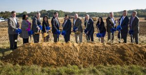 Chesapeake Utilities Corporation held a groundbreaking ceremony for their new Business Campus and CNG fueling station in Dover, Delaware. Pictured from left: Jeffry M. Householder, President, Florida Public Utilities Company and Peninsula Pipeline Company, Inc.; Nicole T. Carter, Assistant Vice President of Customer Care, Chesapeake Utilities Corporation; James F. Moriarty, Vice President, General Counsel & Corporate Secretary, Chesapeake Utilities Corporation; Beth W. Cooper, Senior Vice President, Chief Financial Officer & Assistant Secretary, Chesapeake Utilities Corporation; Stephen C. Thompson, Senior Vice President, Chesapeake Utilities Corporation and Chief Operating Officer, Eastern Shore Natural Gas Company and Sandpiper Energy, Inc.; Robin R. Christiansen, Mayor of Dover, Delaware; Michael P. McMasters, President and Chief Executive Officer of Chesapeake Utilities Corporation; Thomas Carper, U.S. Senator for Delaware; Elaine B. Bittner; Senior Vice President of Strategic Development, Chesapeake Utilities Corporation; Kevin J. Webber, Vice President – Business Development & Gas Operations, Florida Public Utilities Company; Jeffrey R. Tietbohl, Vice President, Eastern Shore Natural Gas Company; and C. James Moore, Vice President, Chesapeake Utilities and Sandpiper Energy, Inc.